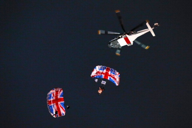 Mark Sutton and Gary Connery jump from a helicopter over the Olympic Stadium during the London 2012 Opening Ceremony