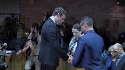 Oscar Pistorius prayed with his brother and sister before the hearing at Pretoria Margistrates Court started today