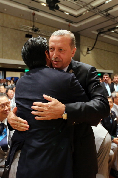 Prime Minister of Japan Shinzo Abe L embraces Prime Minister of Turkey Recep Tayyip Erdogan as Tokyo is awarded the 2020 Summer Olympic Gamesduring the 125th IOC Session